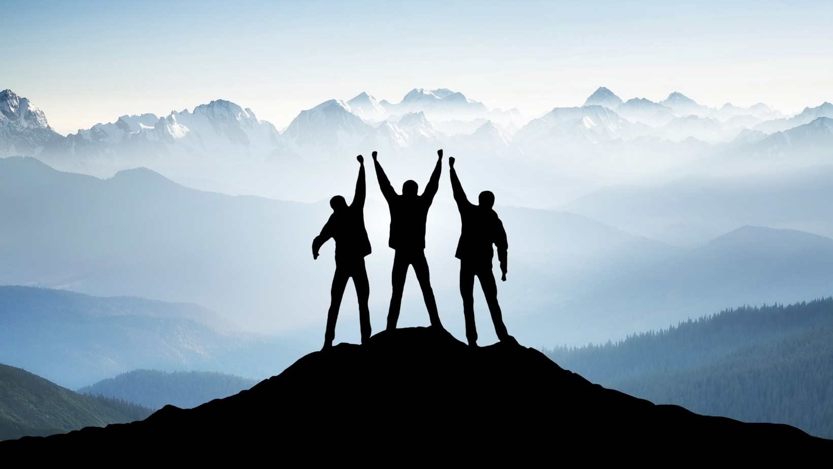 3 people on the top of the mountain